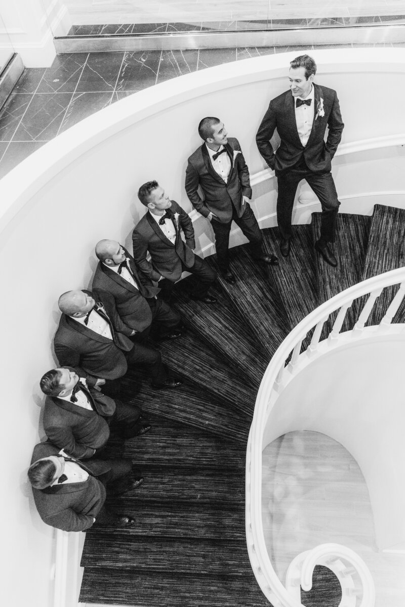 groomsmen standing on stairs at Don Cesar wedding in St Petersburg Florida by Costola photography