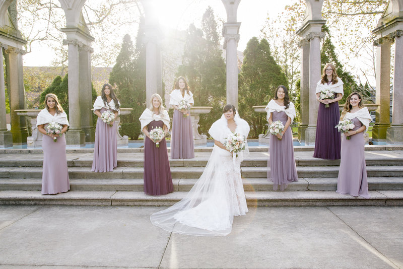 bridesmaids in purple on steps at monmouth university