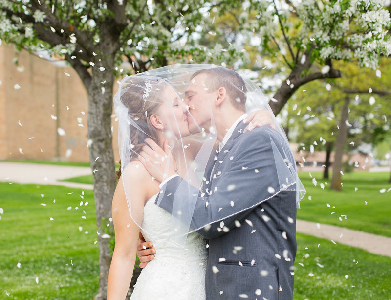 spring wedding bride and groom kiss