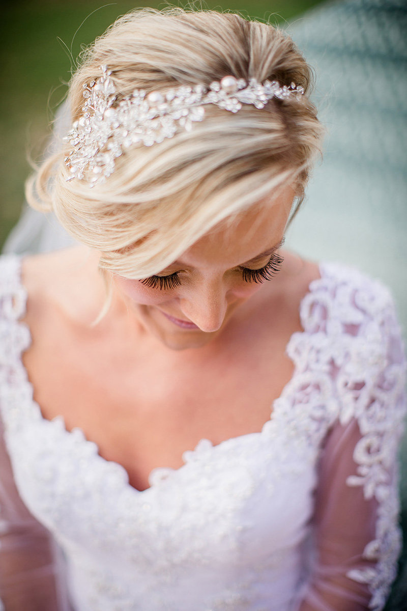 Bride looks down with a marvelous headpiece at Historic Westwood Wedding Venue by Knoxville Wedding Photographer, Amanda May Photos.
