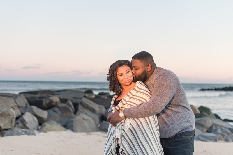 kissing his fiance during engagement session on asbury park beach