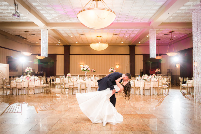 Groom dipping his bride at South Gate Manor