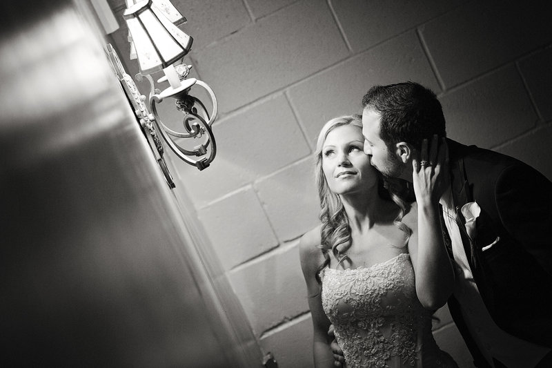 black and white bride and groom in hallways