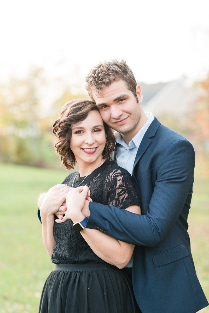 a couple facing the camera wearing fancy clothes  in anniversary session in Graham NC