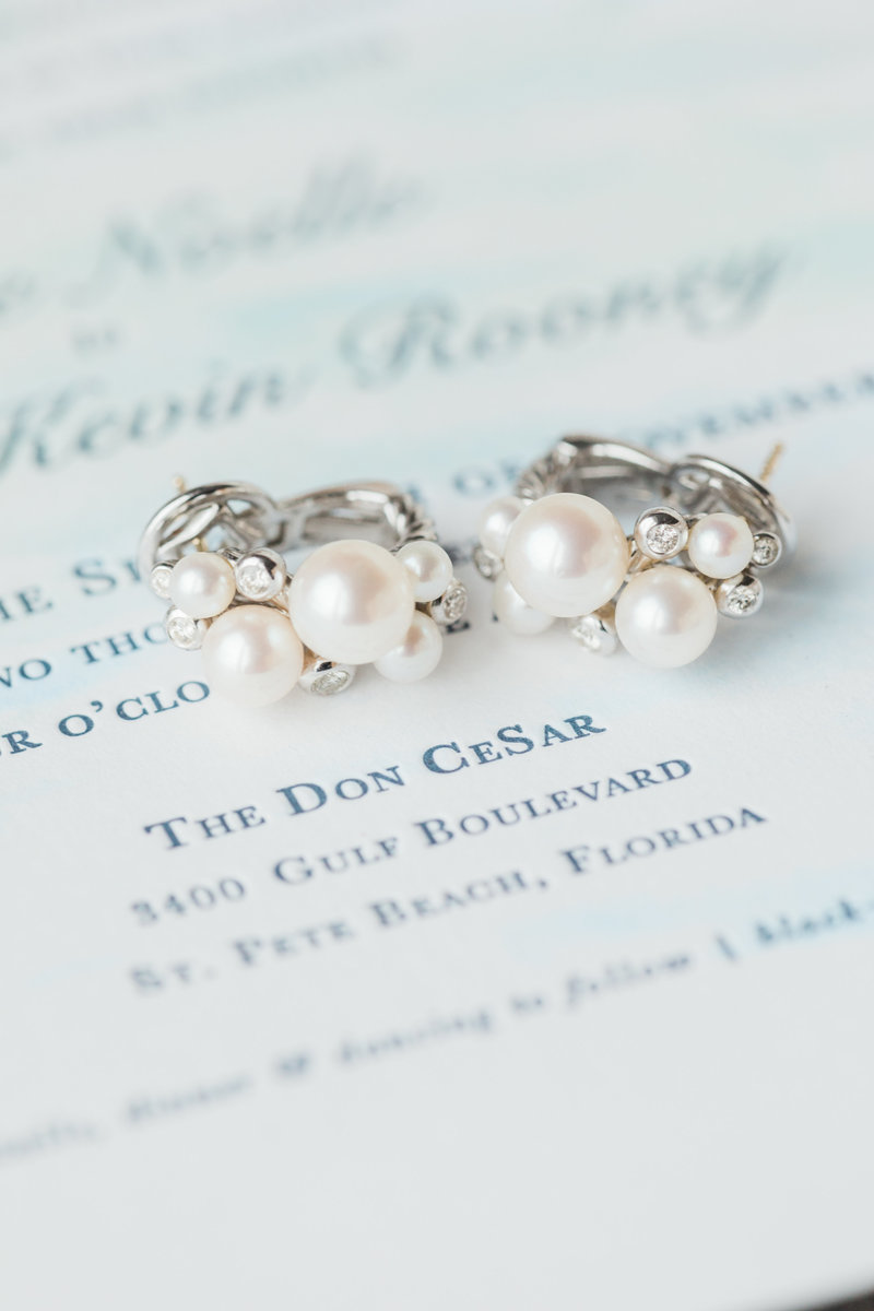 pearl earrings on invitation suite Don Cesar wedding in St Petersburg Florida by Costola photography