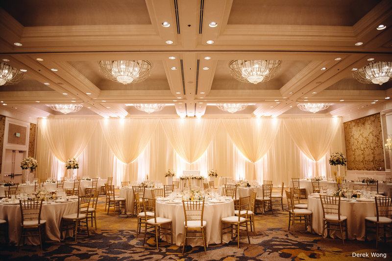 WM Four Seasons Ocean Ballroom ivory matte satin linen pipe & drape gold chiavari chairs wedding