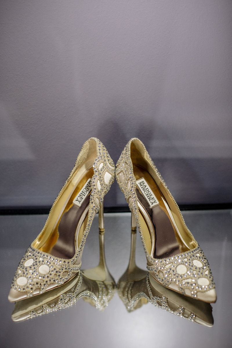 badgley mischka heels  on reflective table