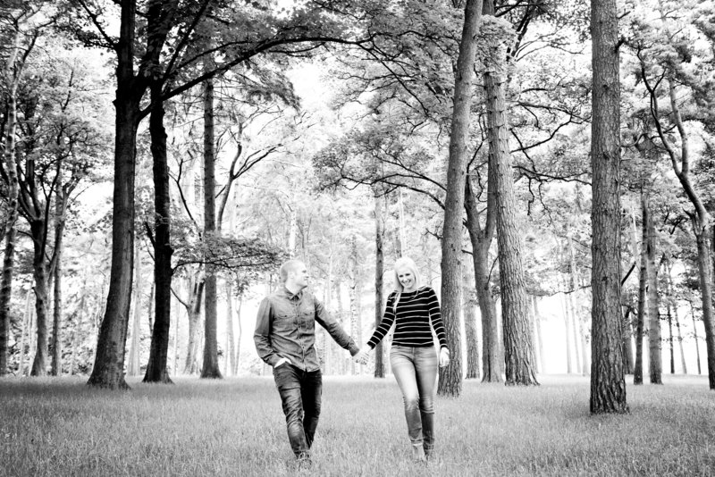 couple walk through the woods of Tatton Park in Knutsford