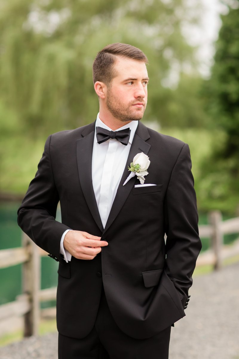 Groom in tuxedo and black tux