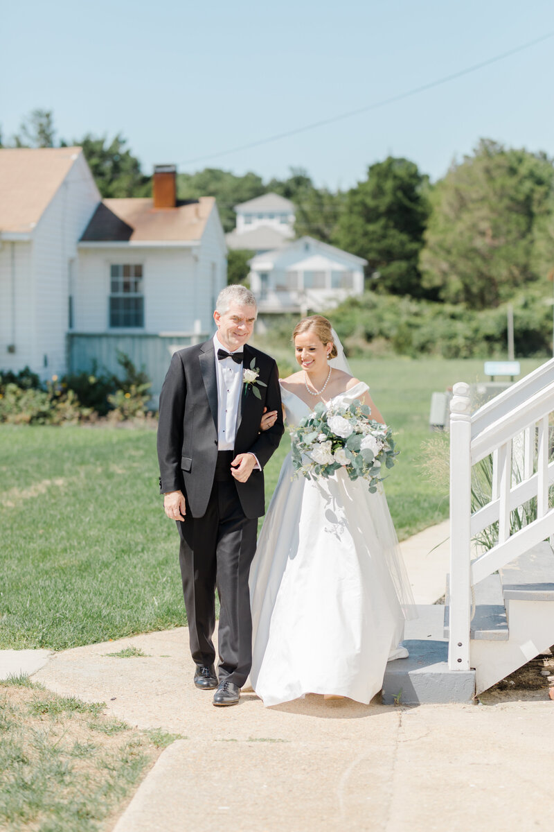 dad walking bride down the aisle at Inn at Perry Cabin wedding in St Michaels Maryland by Costola Photography