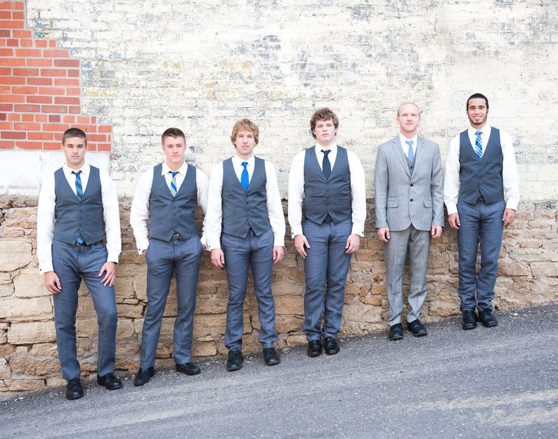 Groom and groomsmen in gray pose for photographer kriskandel