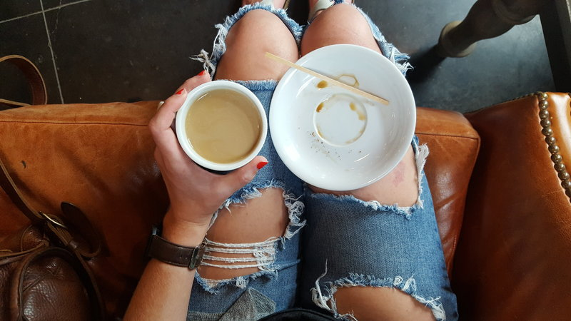 coffee cup in lap