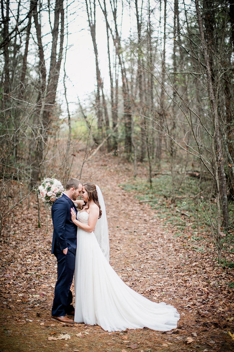 Foreheads together in the woods at Sampson's Hollow Wedding Venue by Knoxville Wedding Photographer, Amanda May Photos.
