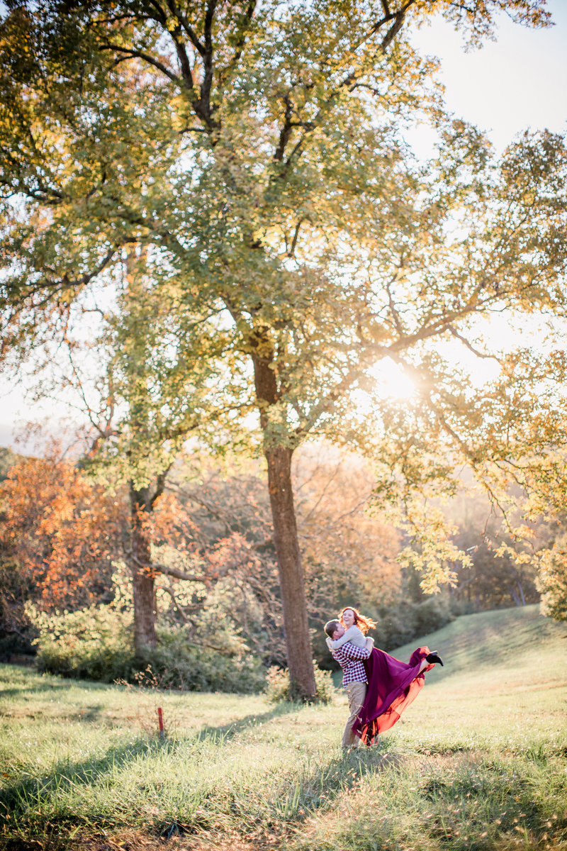 Flinging his bride into the air with the sunlight by Knoxville Wedding Photographer, Amanda May Photos.