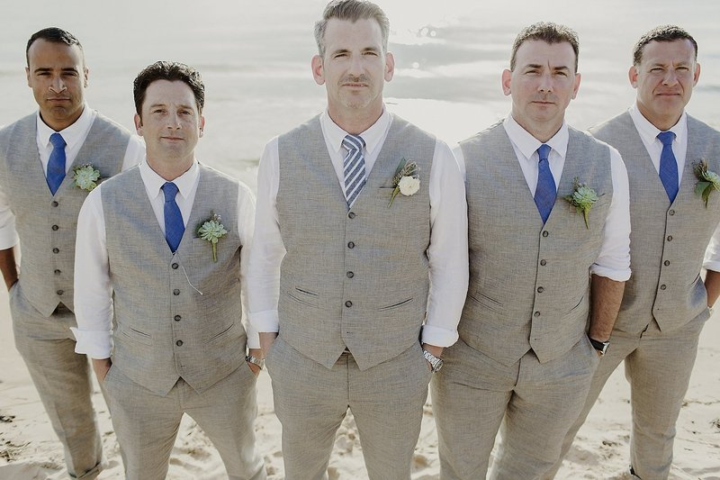 groomsmen on  Grand Haven beach