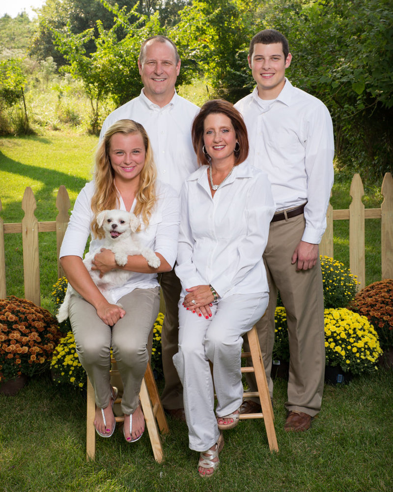 Family of Four Posing for Picture with Dog