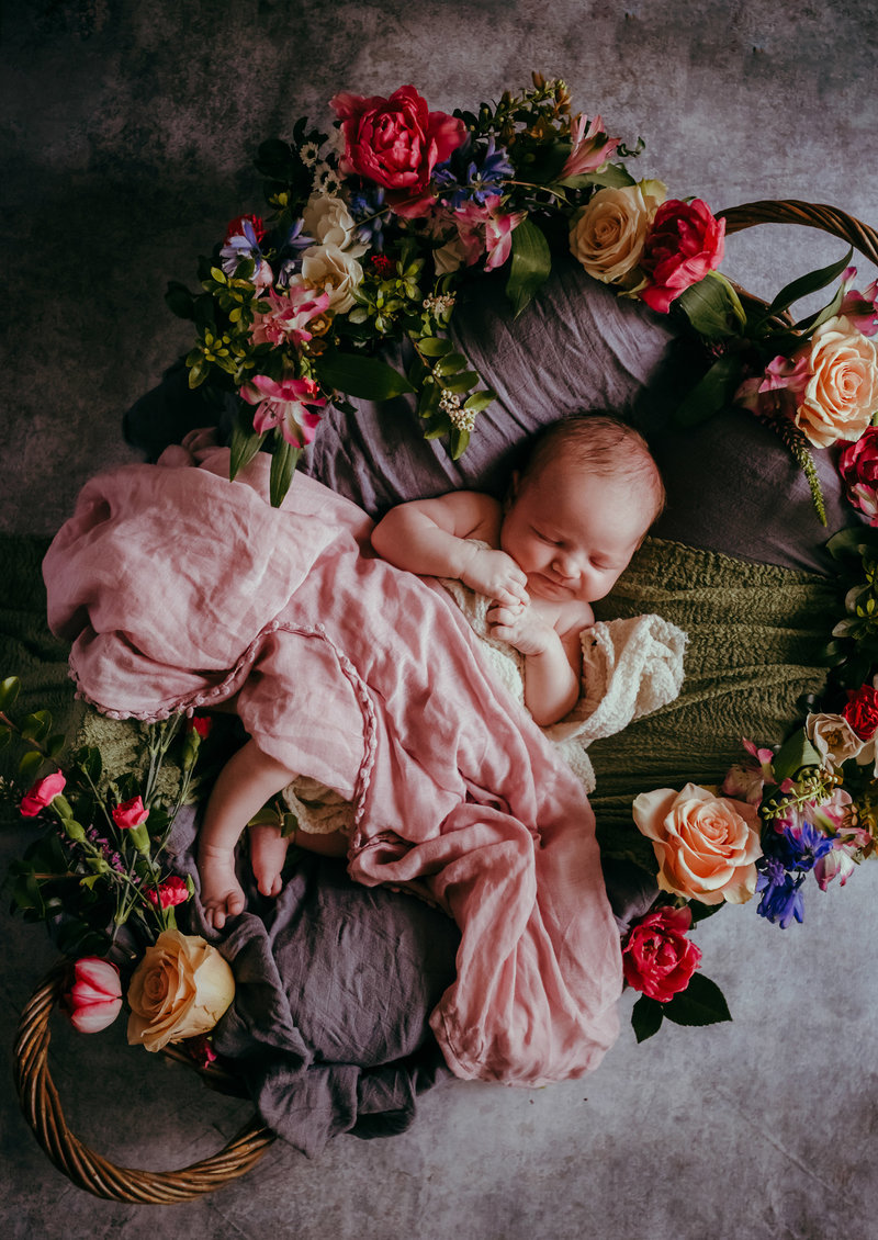rootedandwildphotography_bremerton_newborn_in_basket_with_flowers