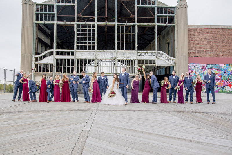 bridal party having fun in asbury park boardwalk