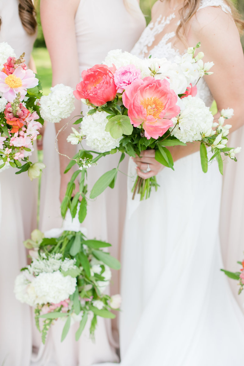 bridesmaids pink bouquets at ocean hall manor