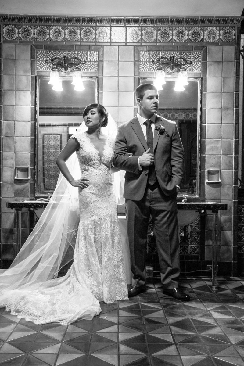 black and white bride and groom in bathroom at monmouth university