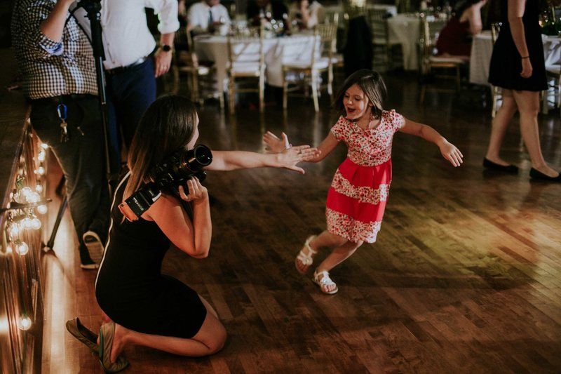 Photographer give little girl high five