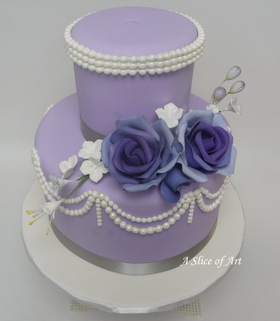 lavender fondant wedding cake with pearls and sugar roses