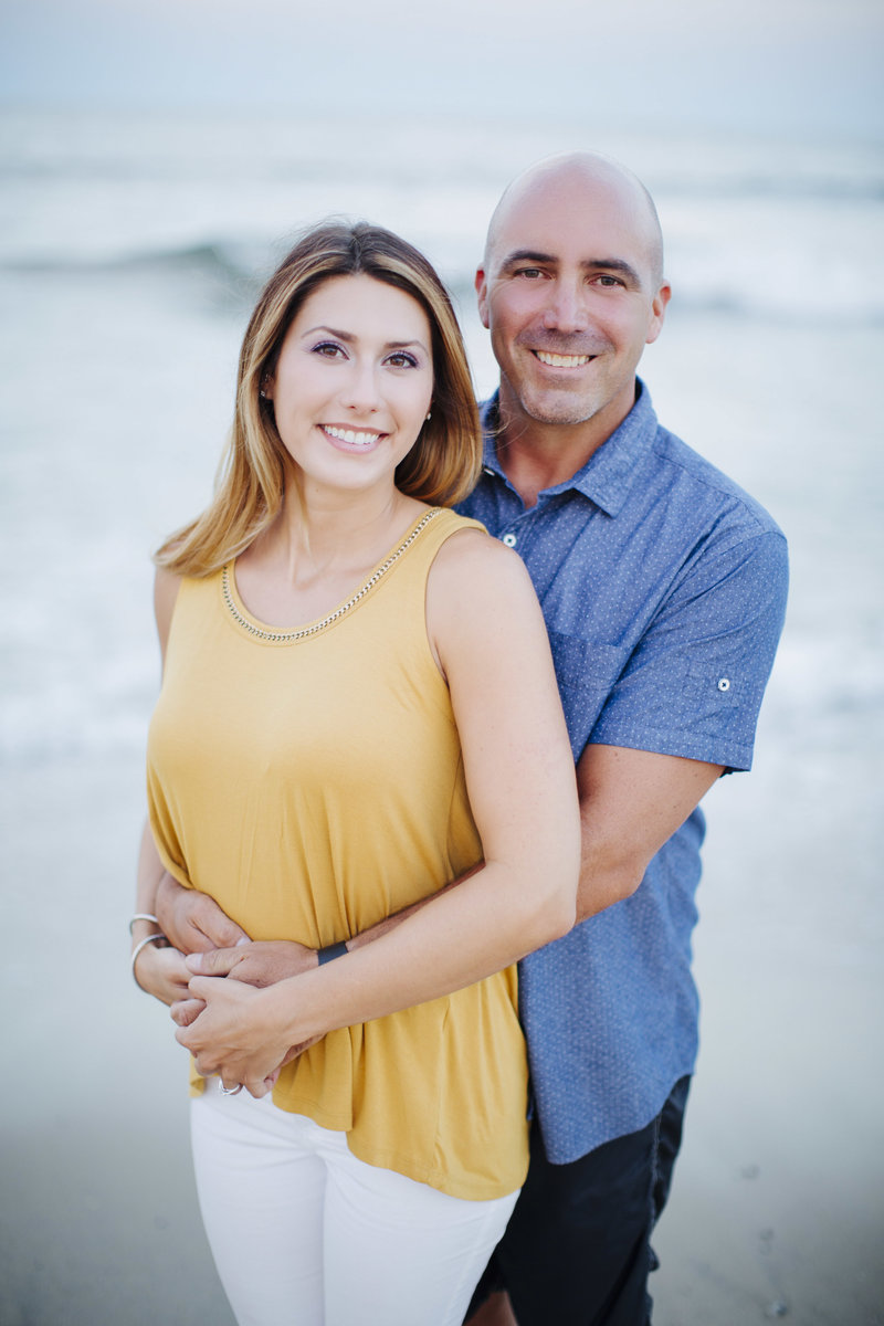 portrait of smiling couple  on beach