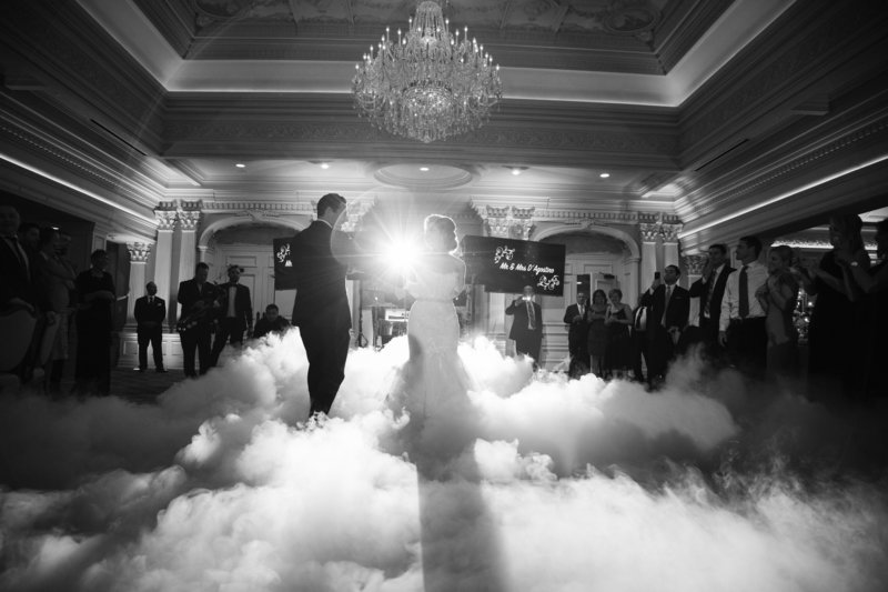 black and white first dance  with light flare and clouds on the floor