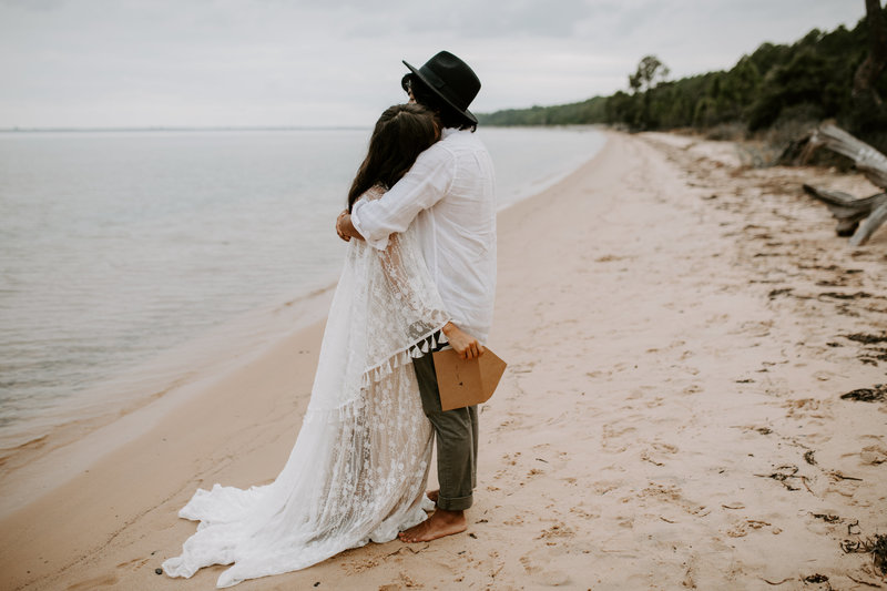 Pensacola Wedding Photographer bride and groom kissing on beach