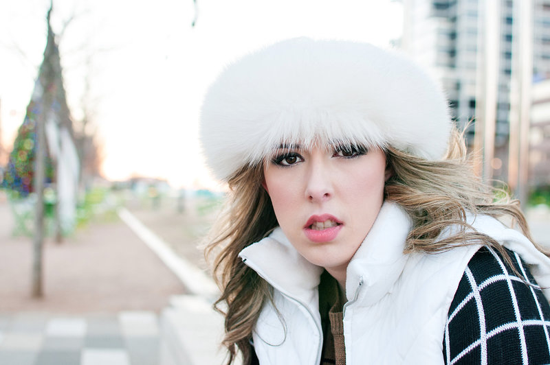 Senior Pictures at Klyde Warren Park in Dallas, Texas with girl wearing a furry hat.