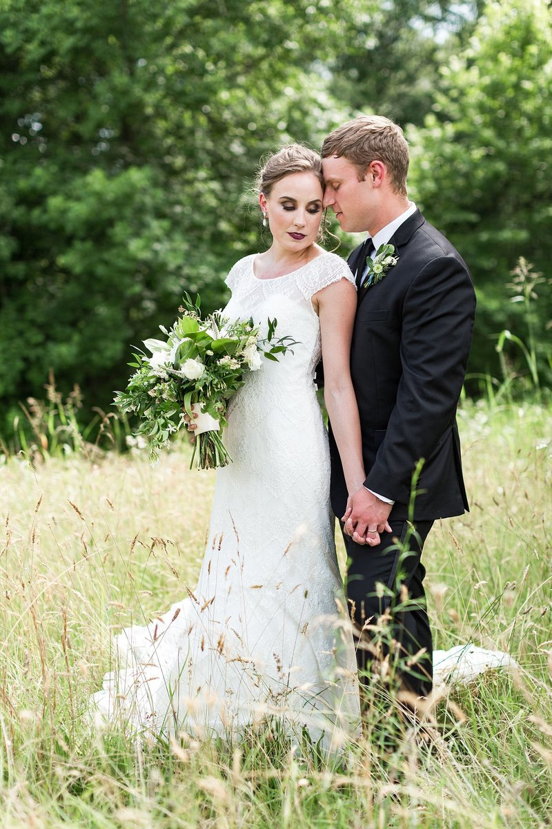 Virginia Wedding Photographer in Richmond with classic lace dress and whimsical bouquet