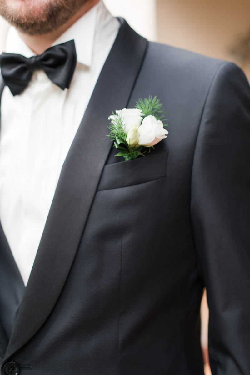 groom details of his flowers and bowtie that is very formal in Italy