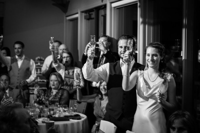 A couple share the toast during the wedding reception at Eagle Crest Resort. Destination Wedding  Photography by Pete Erickson.
