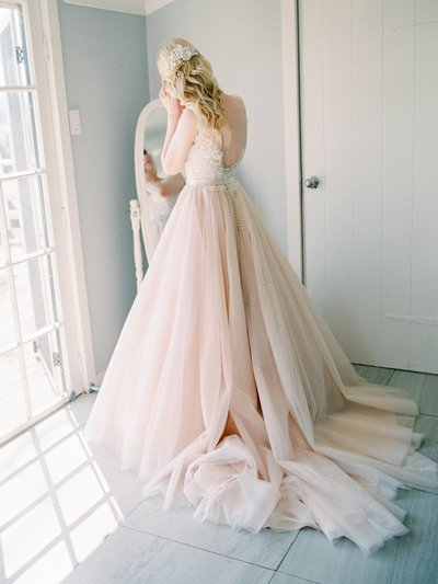 Bride in blush dress Albert River wines