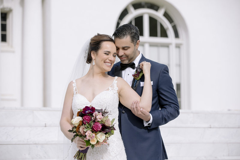 bride and groom smile at Monmouth university