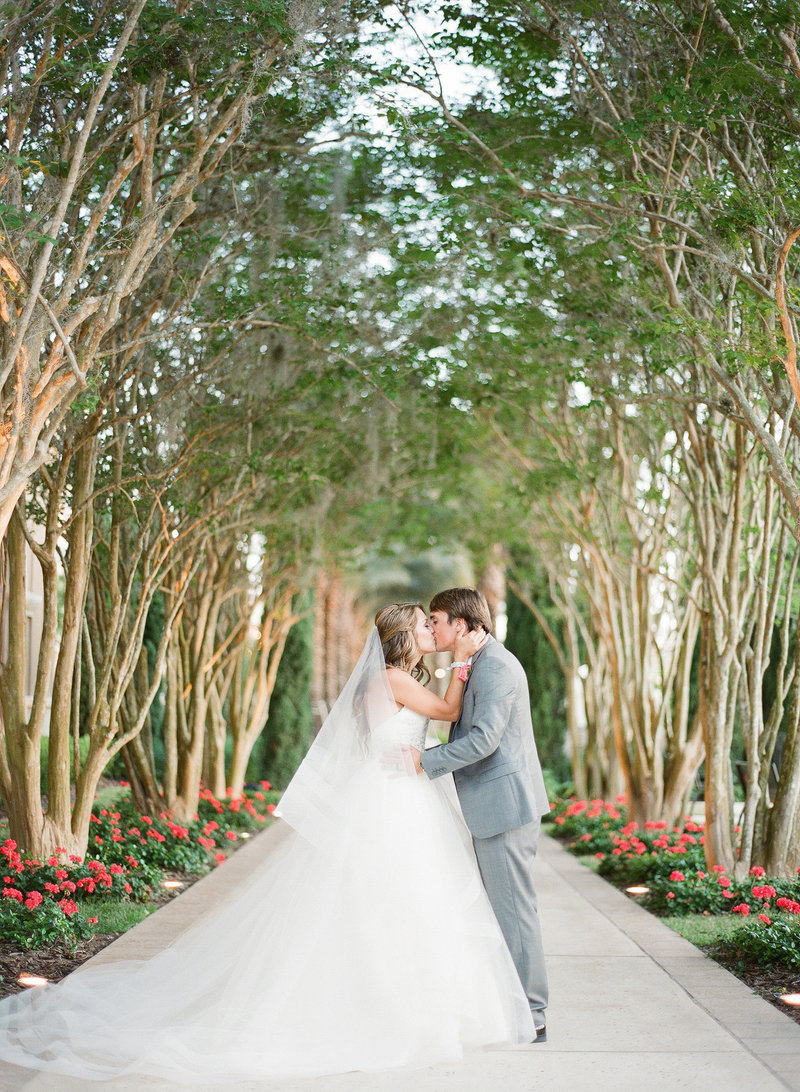 Bride and Groom at Four Seasons Under the trees