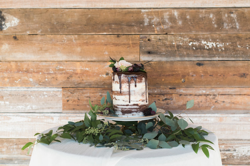 chocolate naked cake on sweetheart table