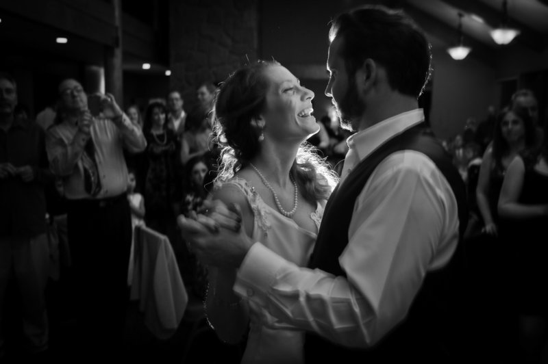 The couple have their first dance during the wedding reception at their destination wedding at Eagle Crest Resort. Pete Erickson Photography.