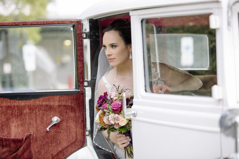 bride coming out of rolls-royce on wedding day