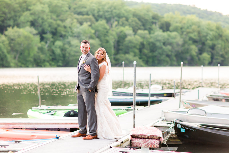 Bride and groom on docks at Lake Valhalla