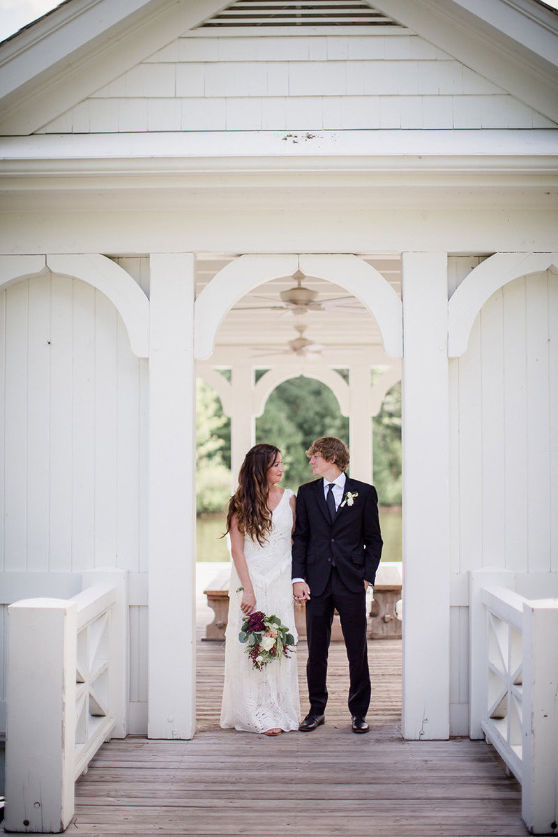 Shoulder to shoulder on the boat house at Blackberry Farms by Knoxville Wedding Photographer, Amanda May Photos.