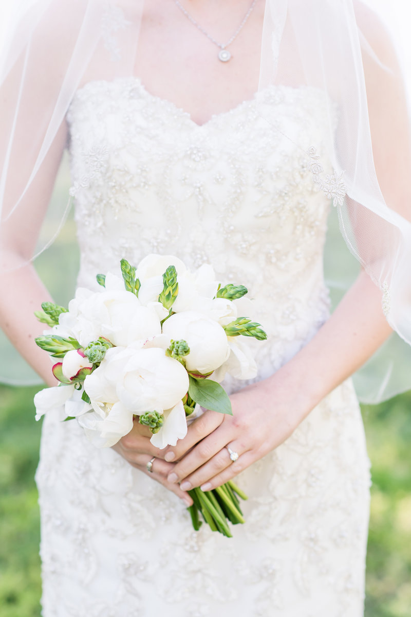 a close up photograph of a green and white bridal bouquet in Burlington