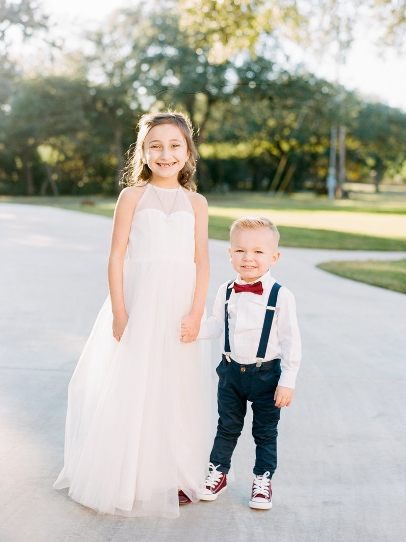 flower girl and ring bearer in suspenders