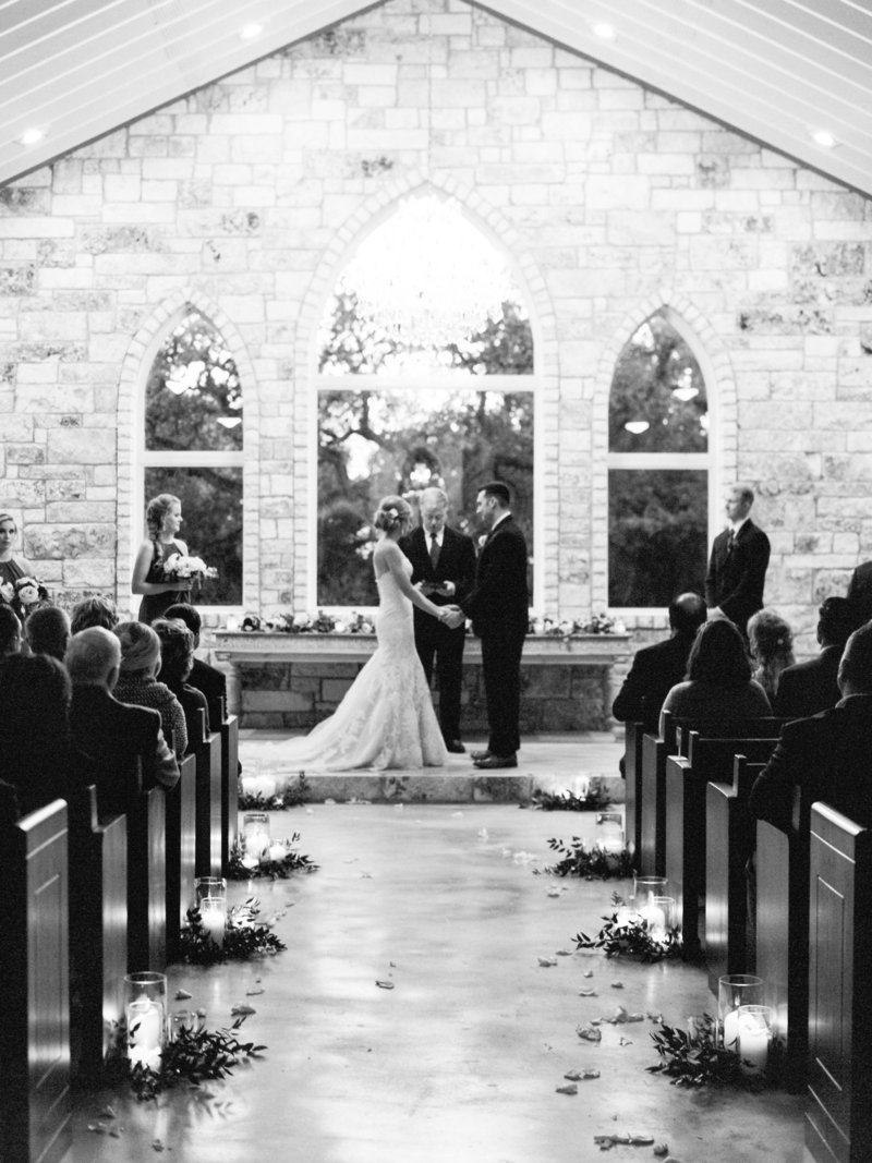 bride and groom with candle lit ceremony, hand in hand