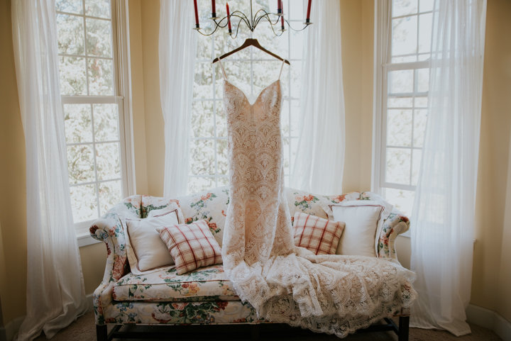 mountain wedding photographer, breckenridge colorado wedding photography, breckenridge wedding photography, breckenridge colorado, wedding dress in window, floral print couch, farmhouse wedding, farmhouse elopements, colorado wedding photgoraphers