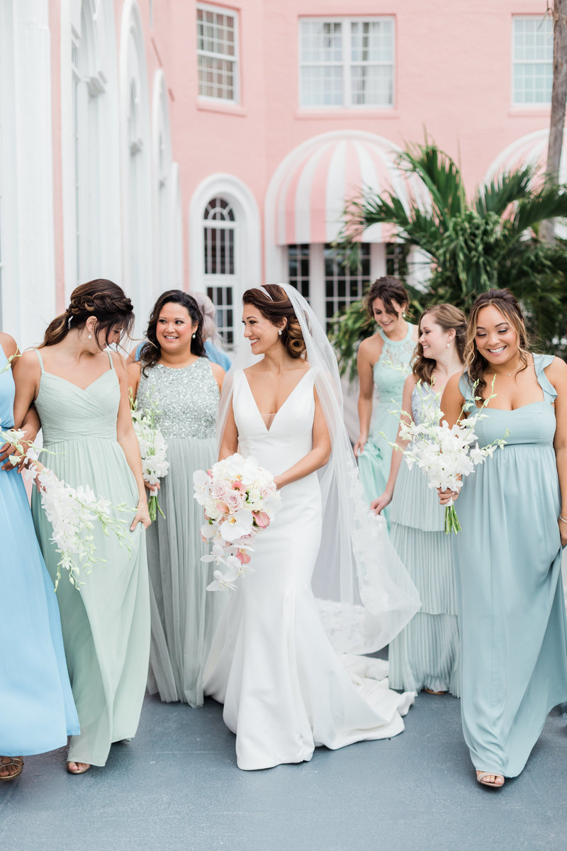 bride and bridesmaids walking at Don Cesar wedding in St Petersburg Florida by Costola photography