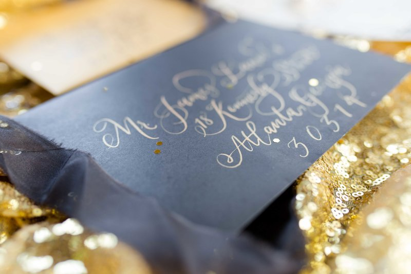 Gold sequins showcase black and gold great gatsby inspired invitations