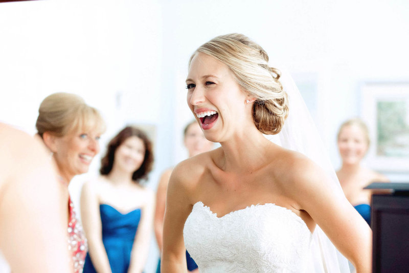 Bride laughs with bridesmaids in background, Old Mill, Rose Valley, Pennsylvania