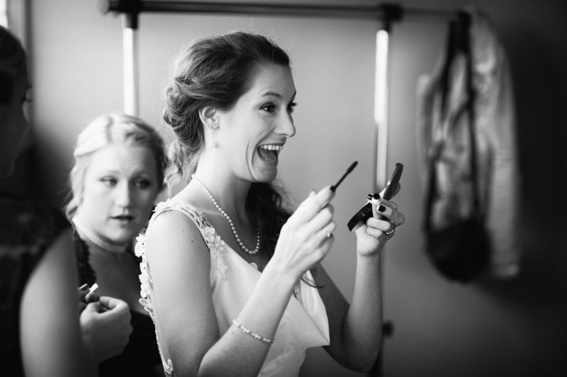 A destination wedding bride having fun getting ready at Eagle Crest Resort in a wedding photography picture by Pete Erickson.