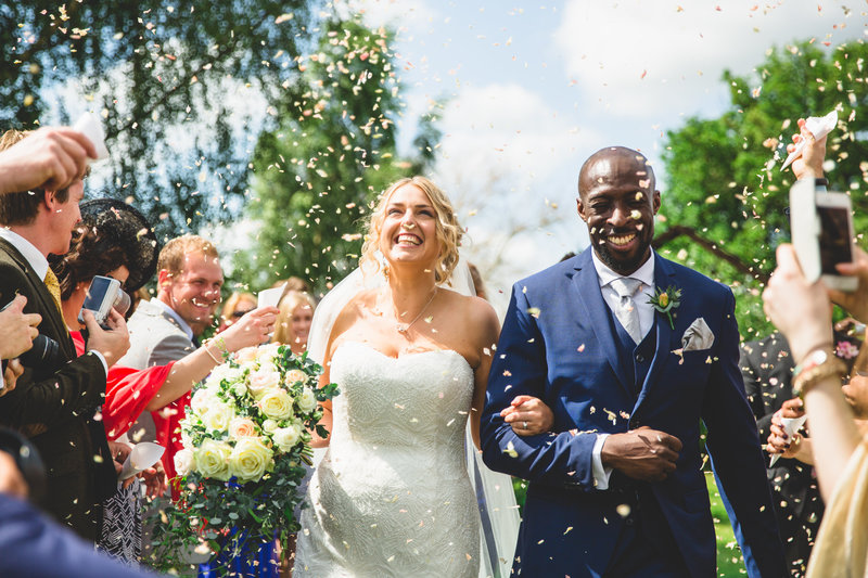 wedding photographer manchester bride and groom confetti